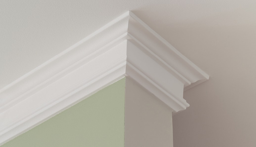 Crown molding wraps around a section of wall.